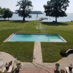 Expertly managed lawn care around a home pool