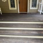A front porch in need of staining
