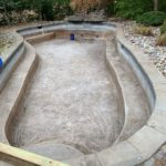 A like-new concrete pool after pressure washing