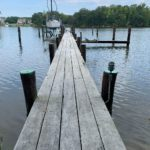 An aged wooden walkway leading to a dock